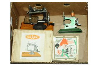 A pair of boxed vintage collectable Children's Sewing Machines