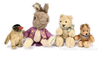 Miniature vintage animals and teddy bears:
